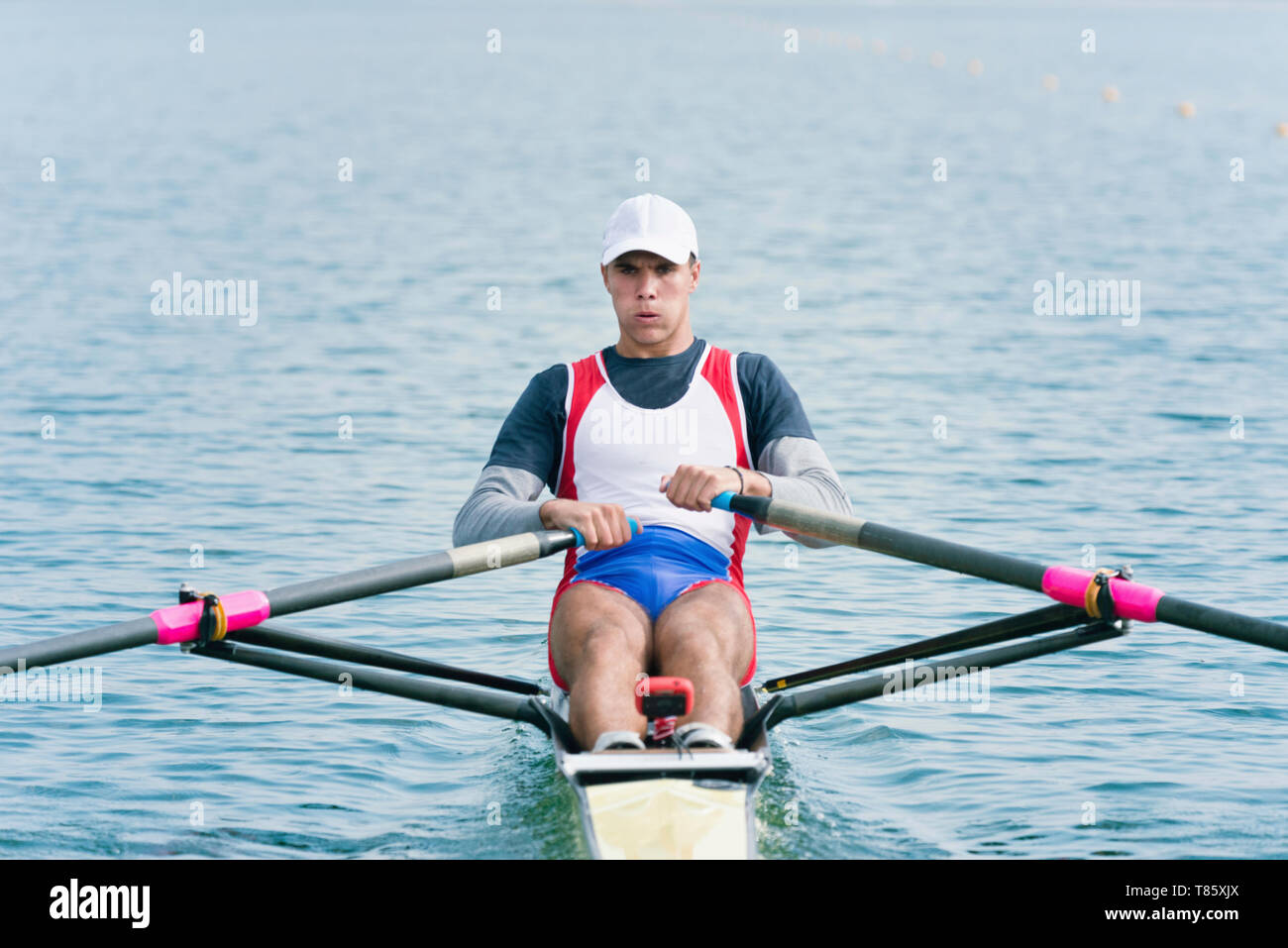 Man rowing scull Stock Photo