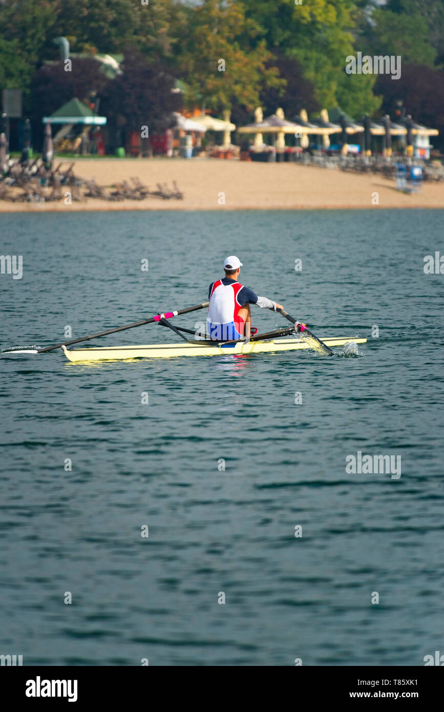 Man rowing scull - Stock Image