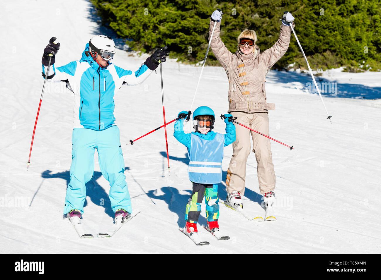 Happy family skiing - Stock Image