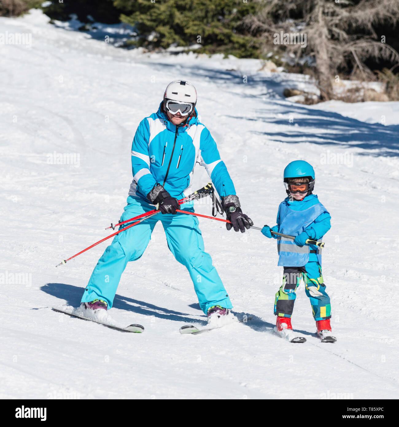 Boy having skiing lesson - Stock Image