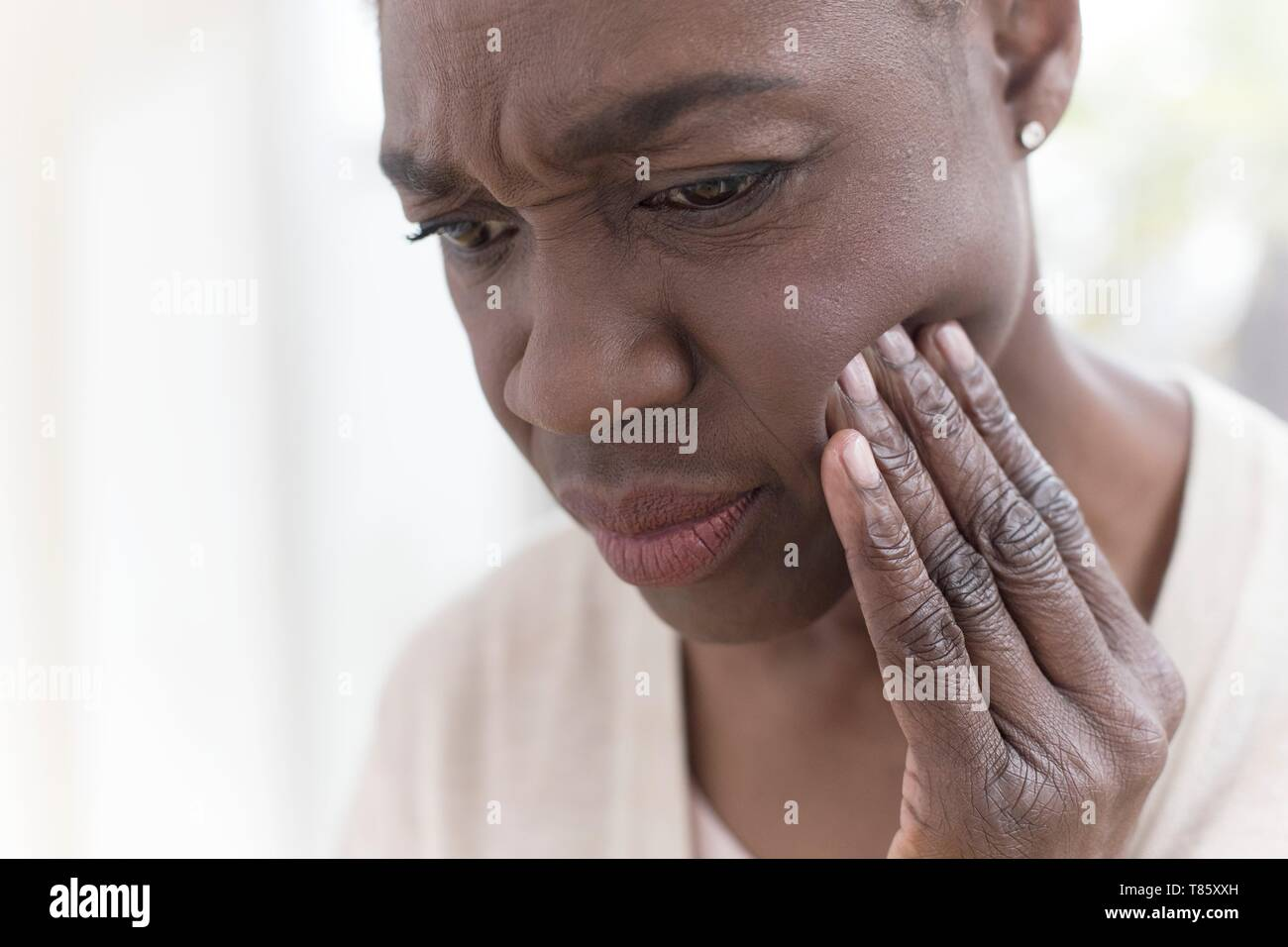 Woman with tooth ache - Stock Image