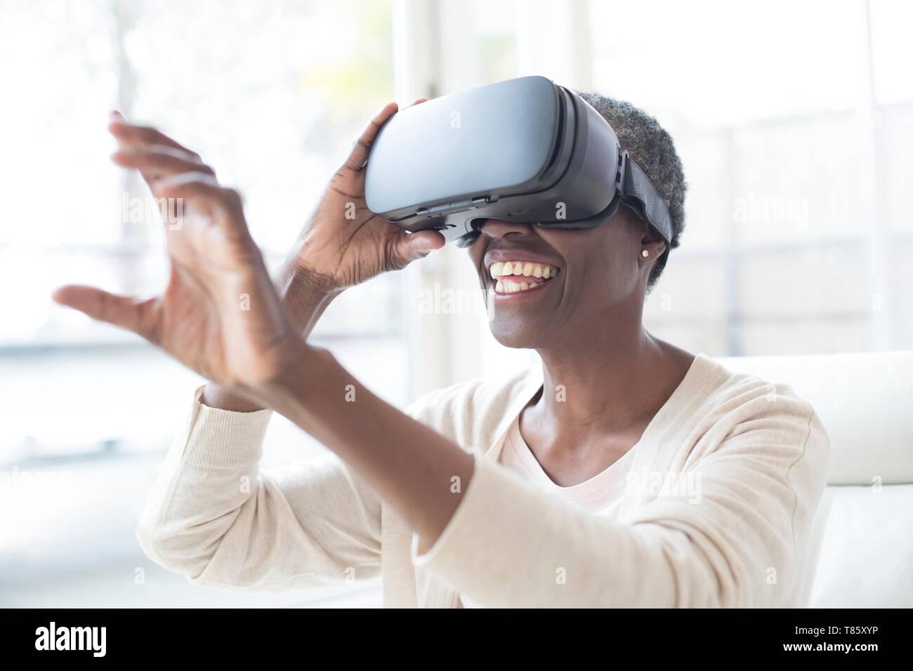 Woman wearing VR headset - Stock Image