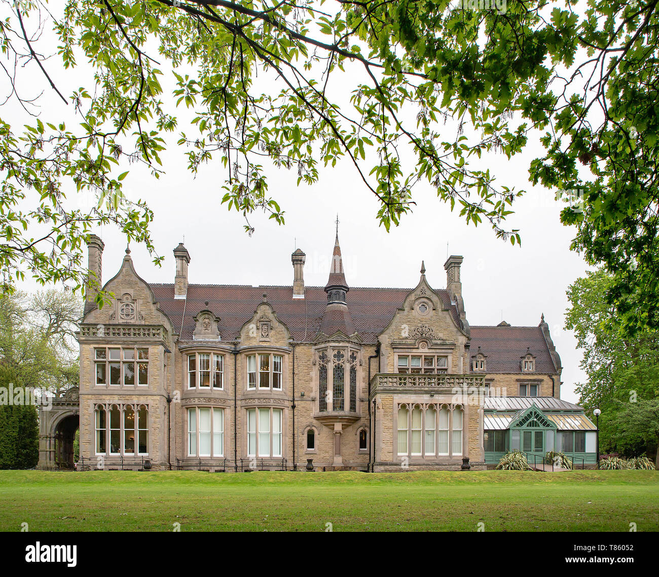 Denzell House within the ornate gardens, Dunham Rd, Bowdon, Trafford, Greater Manchester - Stock Image