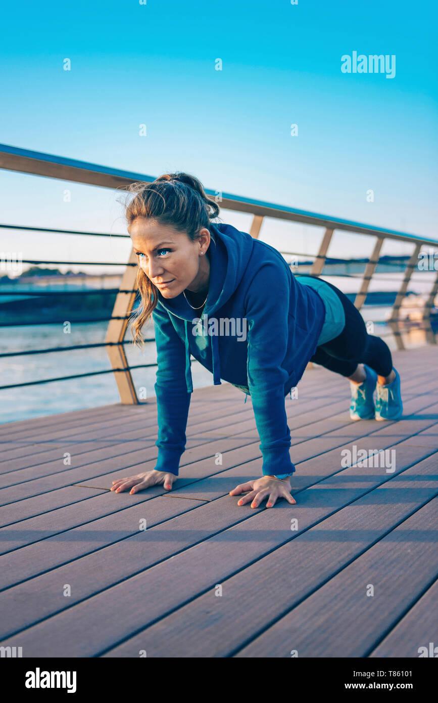 Woman exercising outside Stock Photo