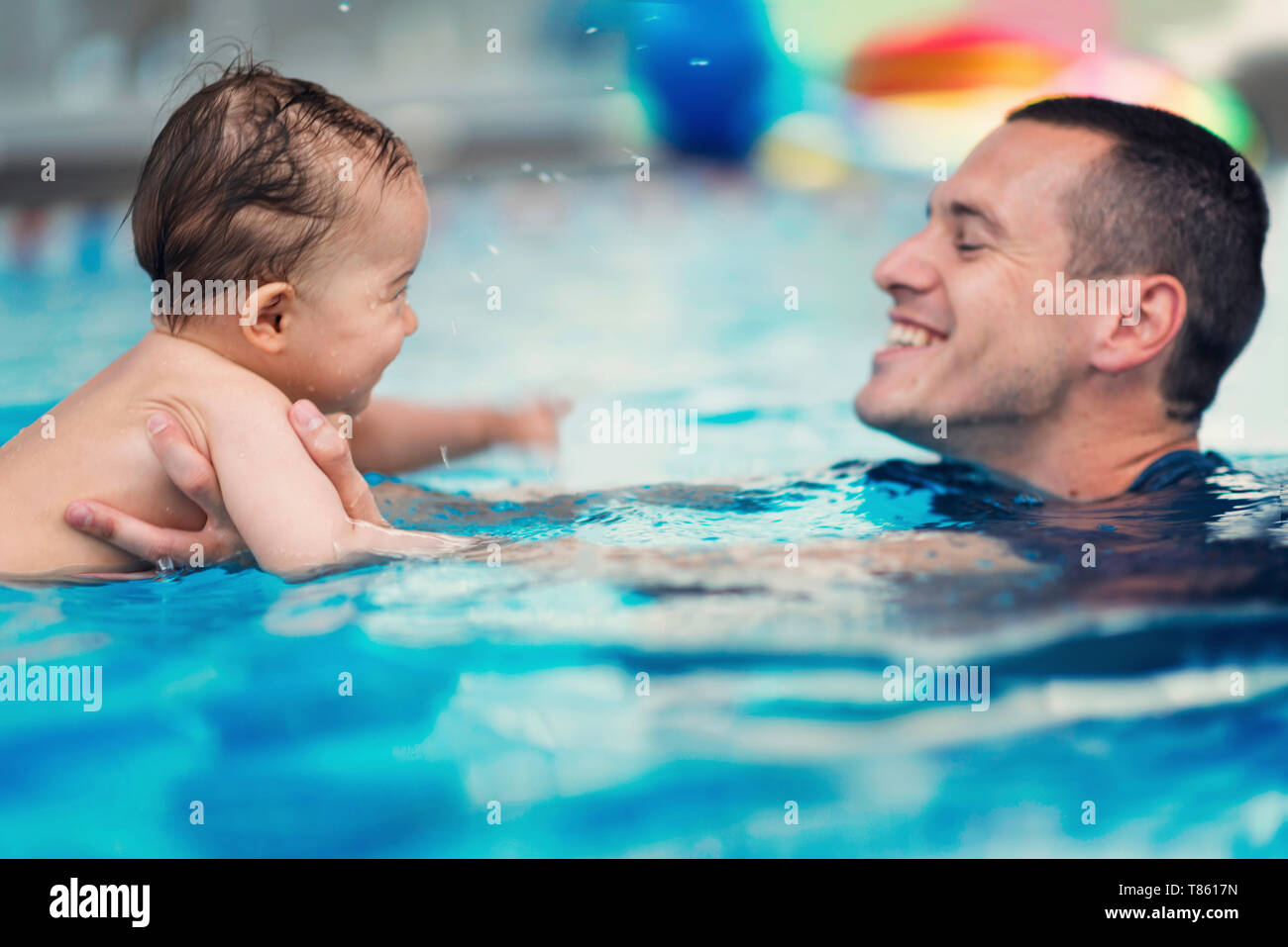 Baby swimming lesson Stock Photo