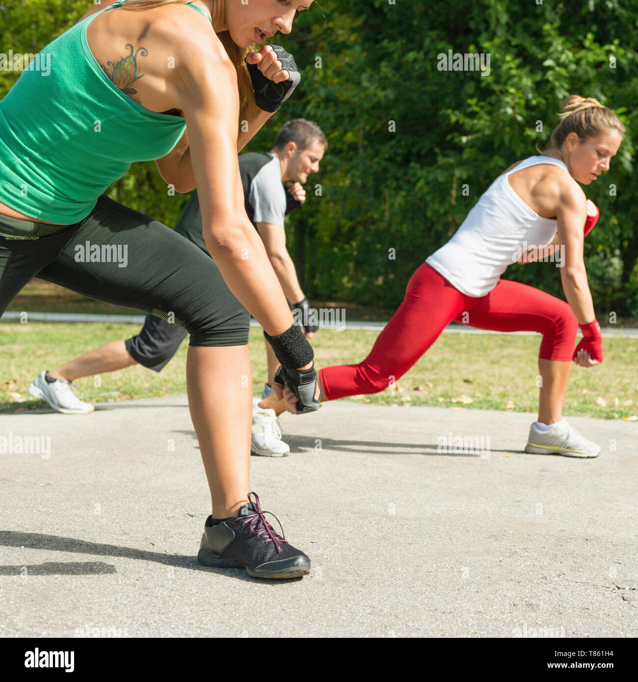 Kickboxing training outdoors - Stock Image
