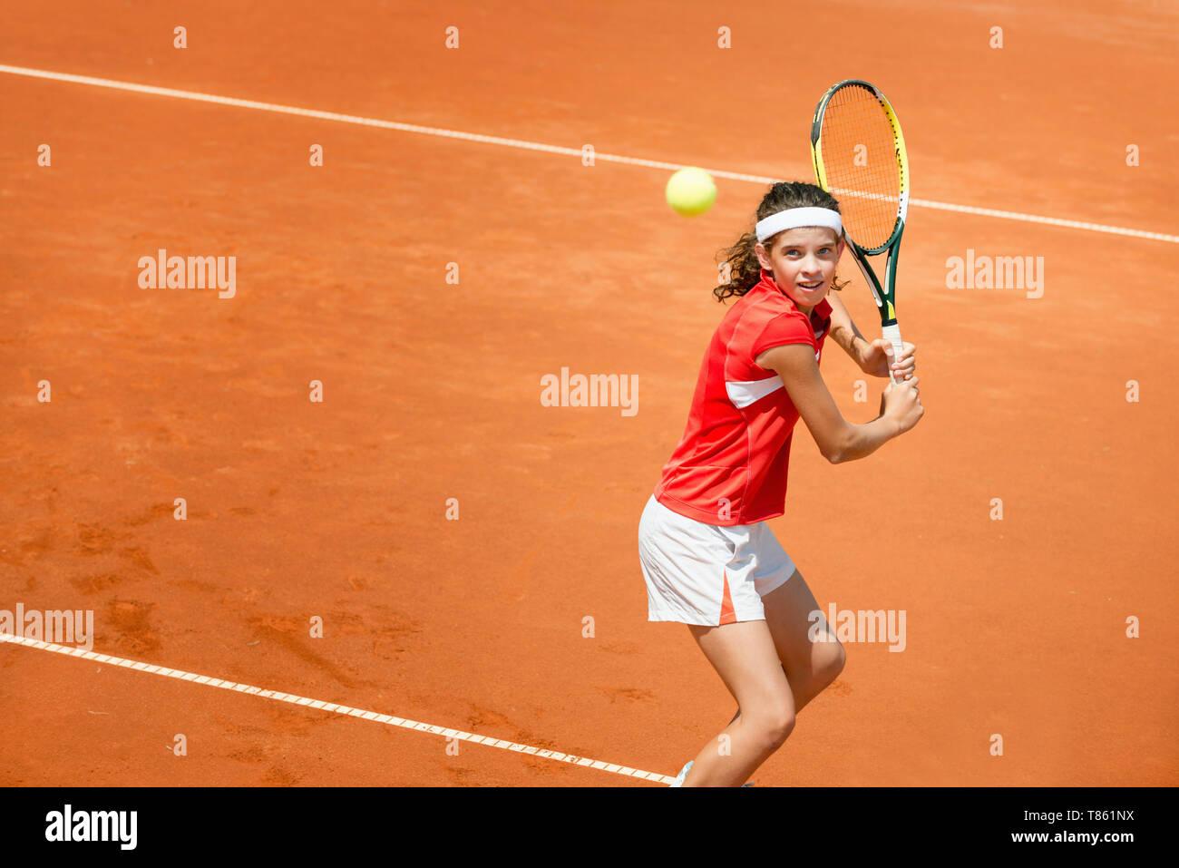 Girl playing tennis - Stock Image