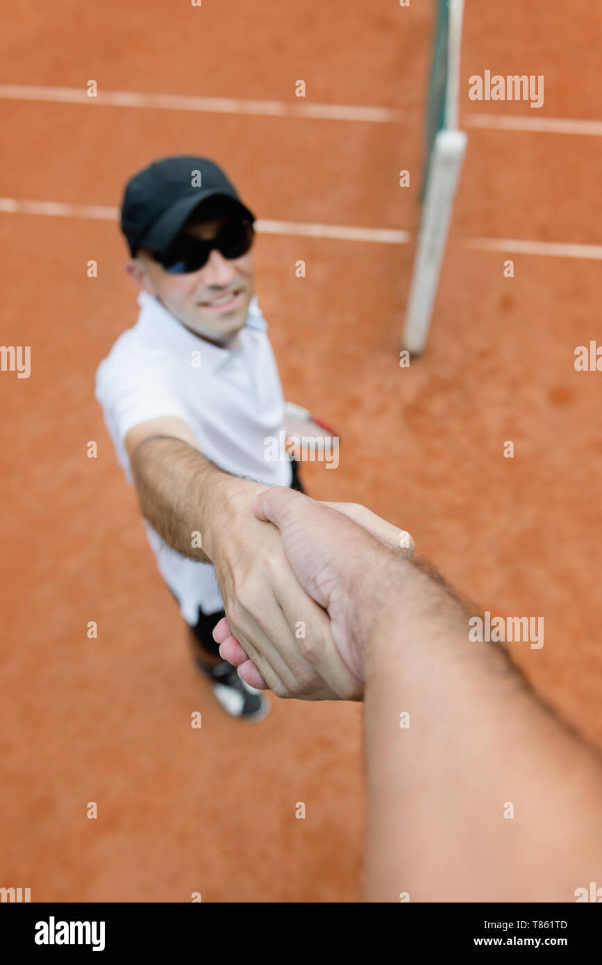 Tennis player shaking hands with chair umpire - Stock Image