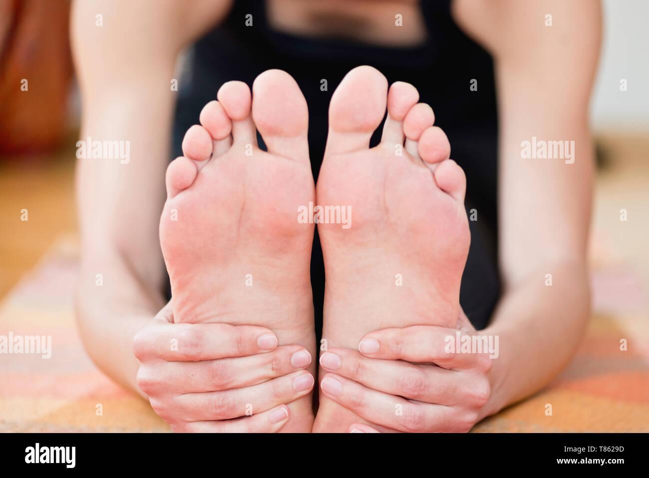 Yoga forward bend - Stock Image