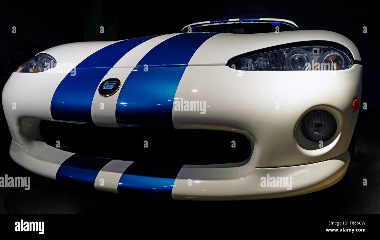 Close up of the sleek grill and front end of a very rare Wimbledon White and Guardian Blue 1995 Carroll Shelby Dodge Viper RT/10 sports car. - Stock Image