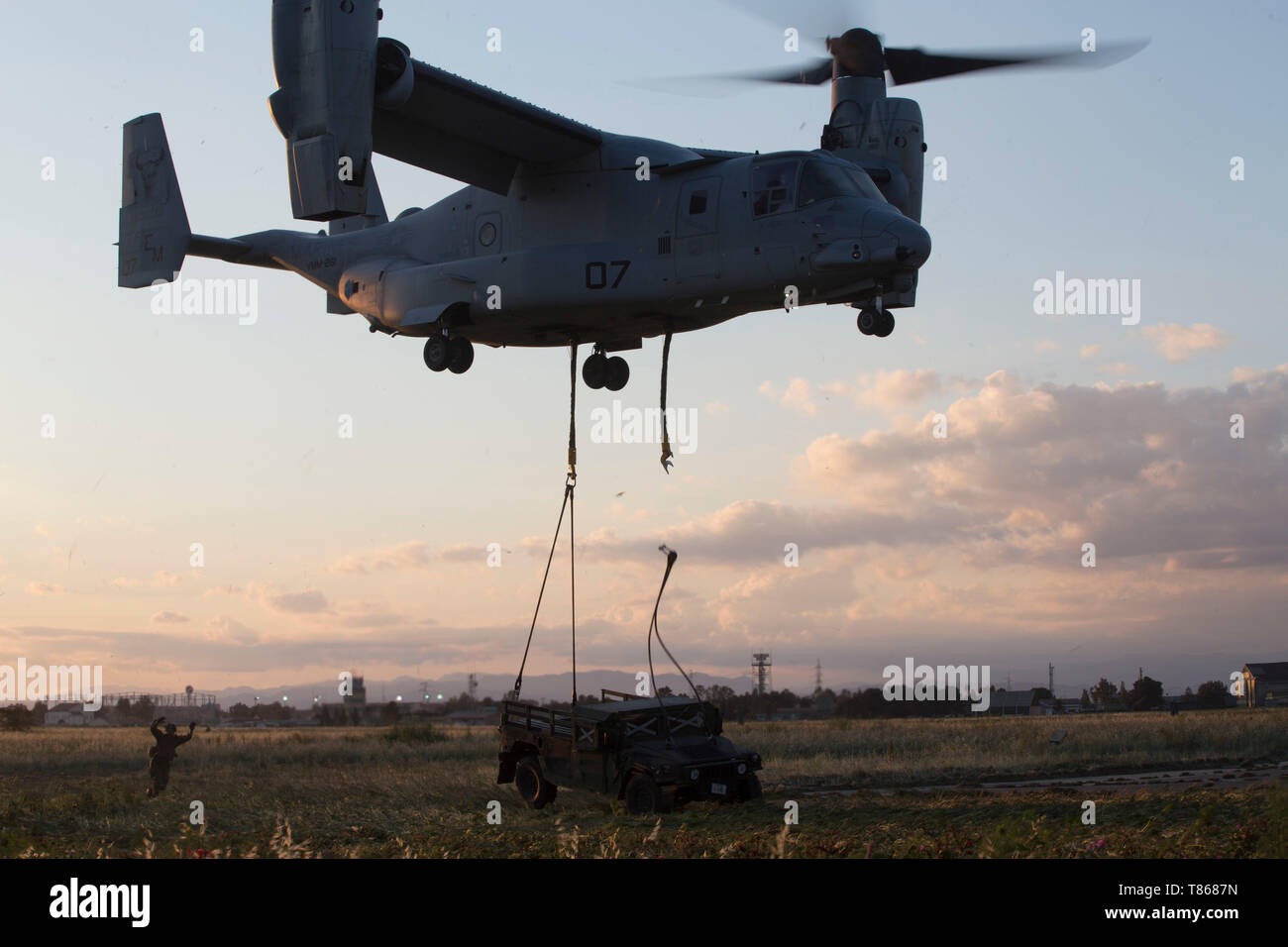 A U.S. Marine Corps MV-22B Osprey with Special Purpose Marine Air-Ground Task Force-Crisis Response-Africa 19.2, Marine Forces Europe and Africa, releases a humvee during external-lift training at Naval Air Station Sigonella, Italy, May 1, 2019. SPMAGTF-CR-AF is deployed to conduct crisis-response and theater-security operations in Africa and promote regional stability by conducting military-to-military training exercises throughout Europe and Africa. (U.S. Marine Corps photo by Staff Sgt. Mark E. Morrow Jr. ) Stock Photo