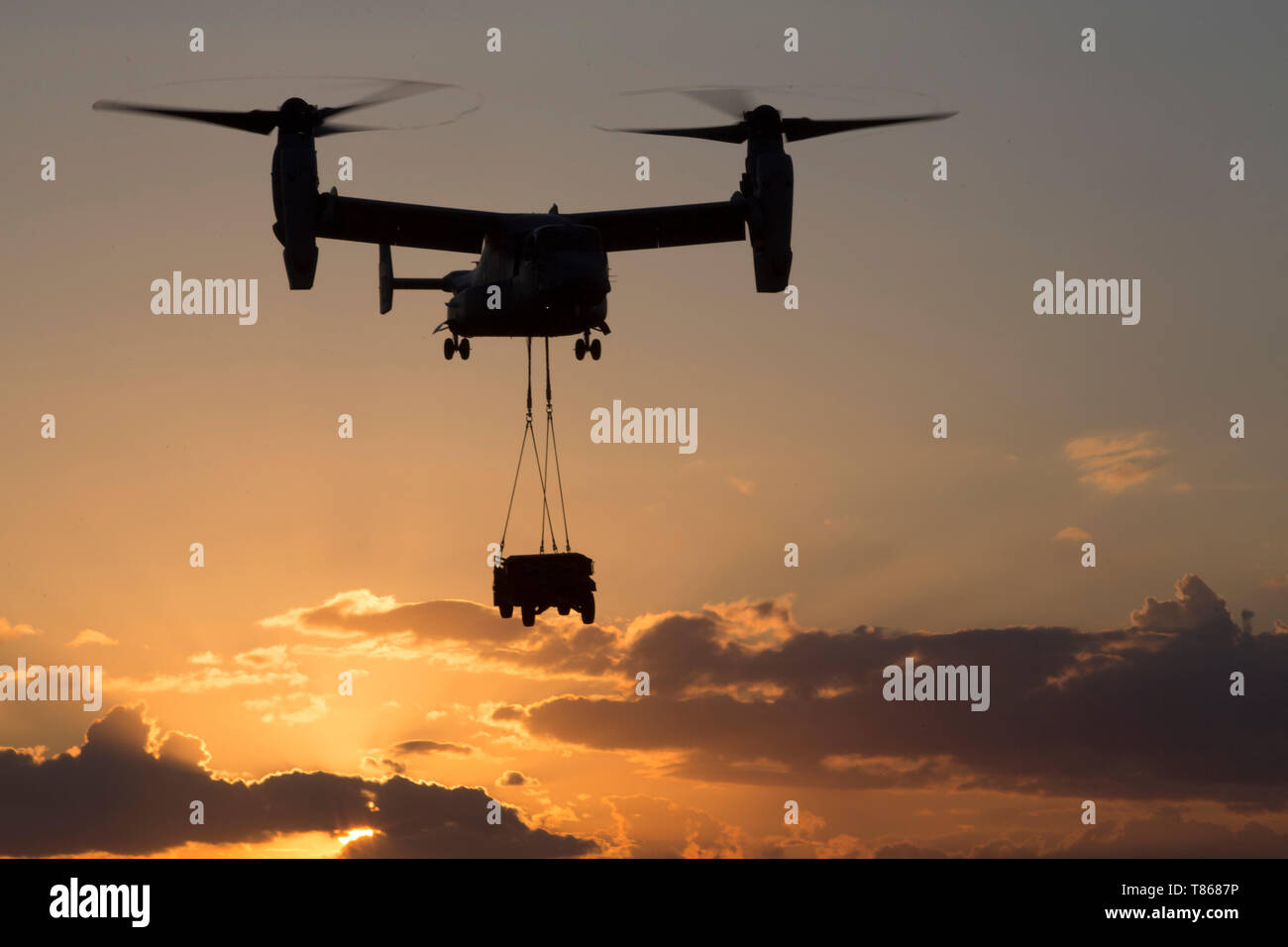 A U.S. Marine Corps MV-22B Osprey with Special Purpose Marine Air-Ground Task Force-Crisis Response-Africa 19.2, Marine Forces Europe and Africa, lifts a humvee during external-lift training at Naval Air Station Sigonella, Italy, May 1, 2019. SPMAGTF-CR-AF is deployed to conduct crisis-response and theater-security operations in Africa and promote regional stability by conducting military-to-military training exercises throughout Europe and Africa. (U.S. Marine Corps photo by Staff Sgt. Mark E. Morrow Jr. ) Stock Photo
