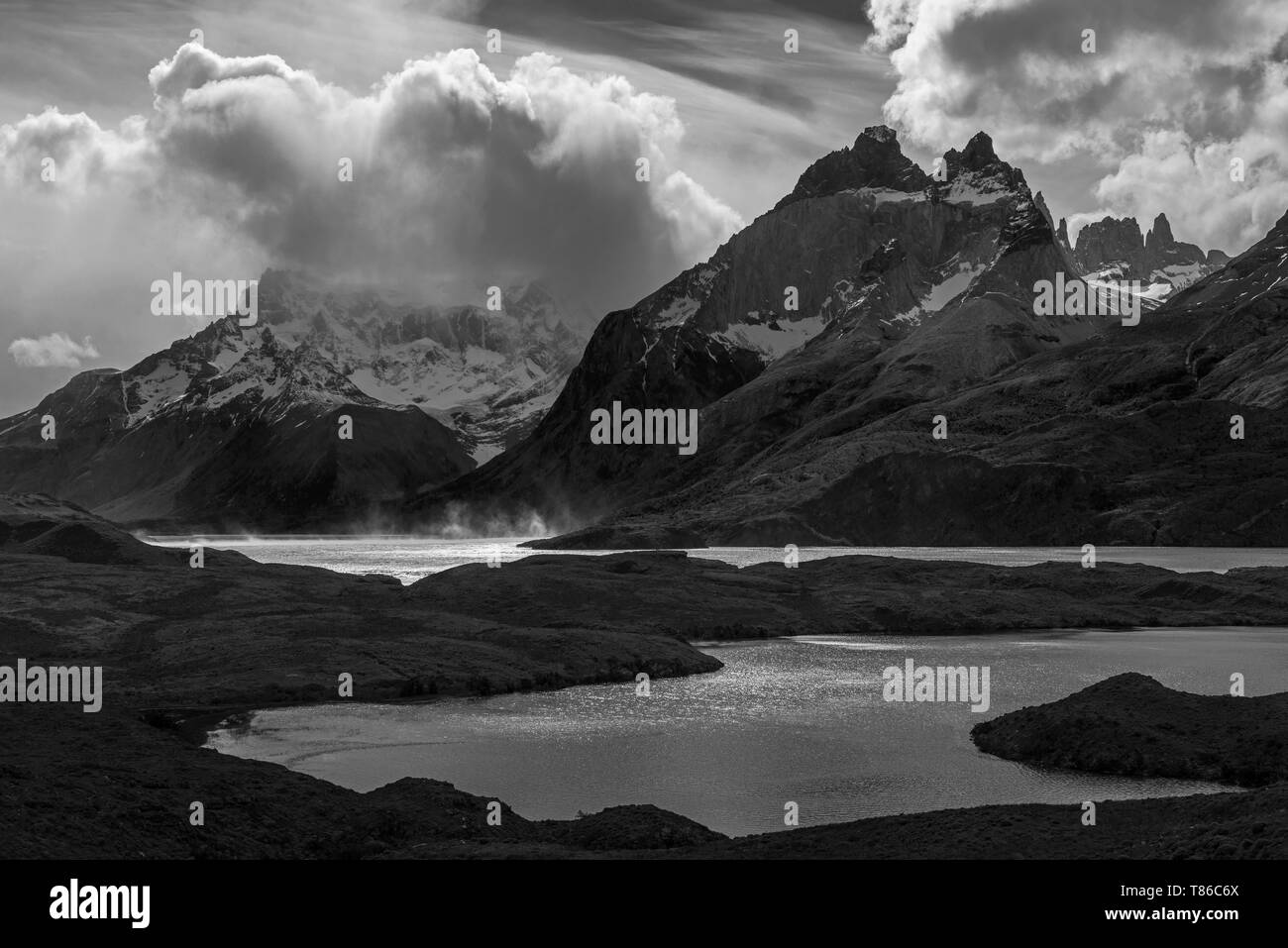 Black and white photograph of Nordenskjold and Pehoe Lake during a strong wind storm in Torres del Paine national park, Patagonia, Chile. - Stock Image