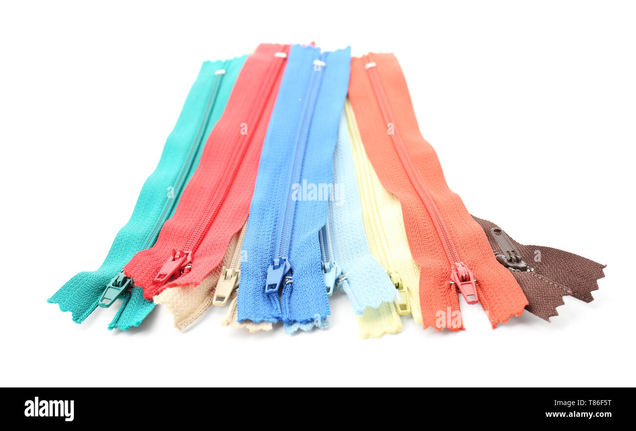 Colourful zippers on white background - Stock Image