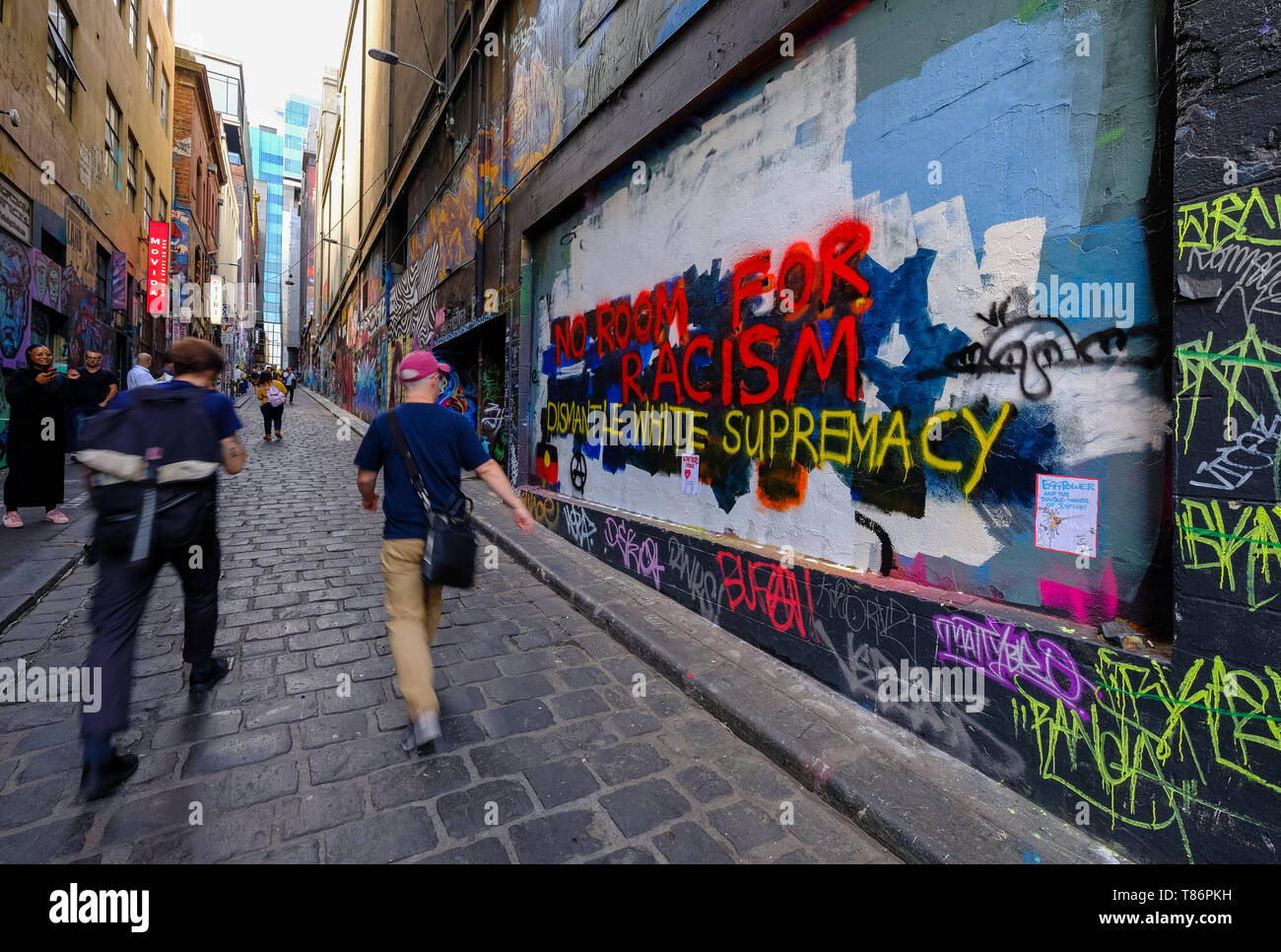 The mural honouring 'Egg Boy' Will Connolly who smashed an egg on Fraser Anning's head was painted over with an anti-racism message a few days later. - Stock Image