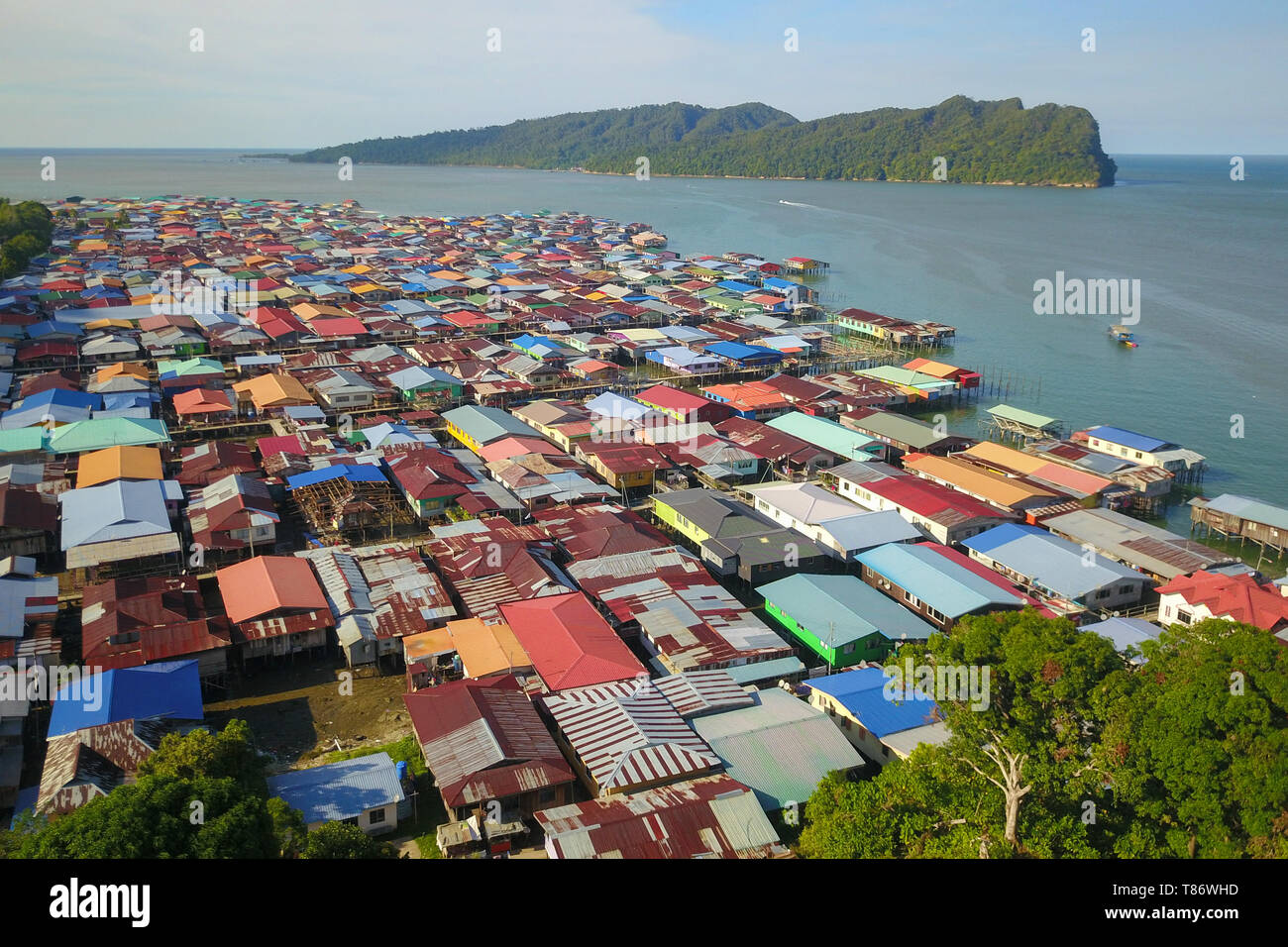 Kg. Sim Sim traditional water village located along seafront. Sandakan once known as Little Hong Kong of Borneo. - Stock Image