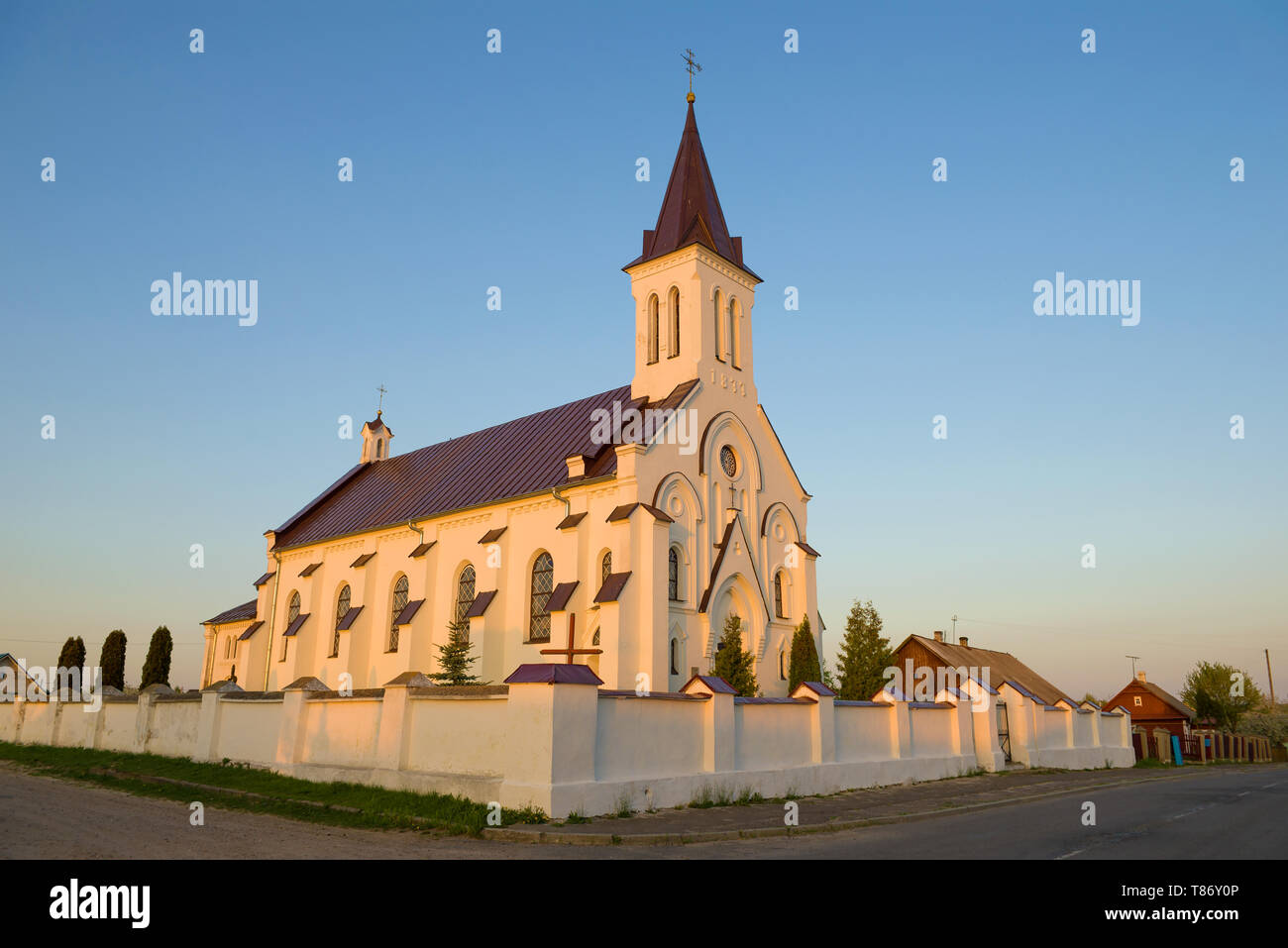 The ancient church of the Holy Trinity and the Holy Cross in April evening. Kossovo, Belarus - Stock Image