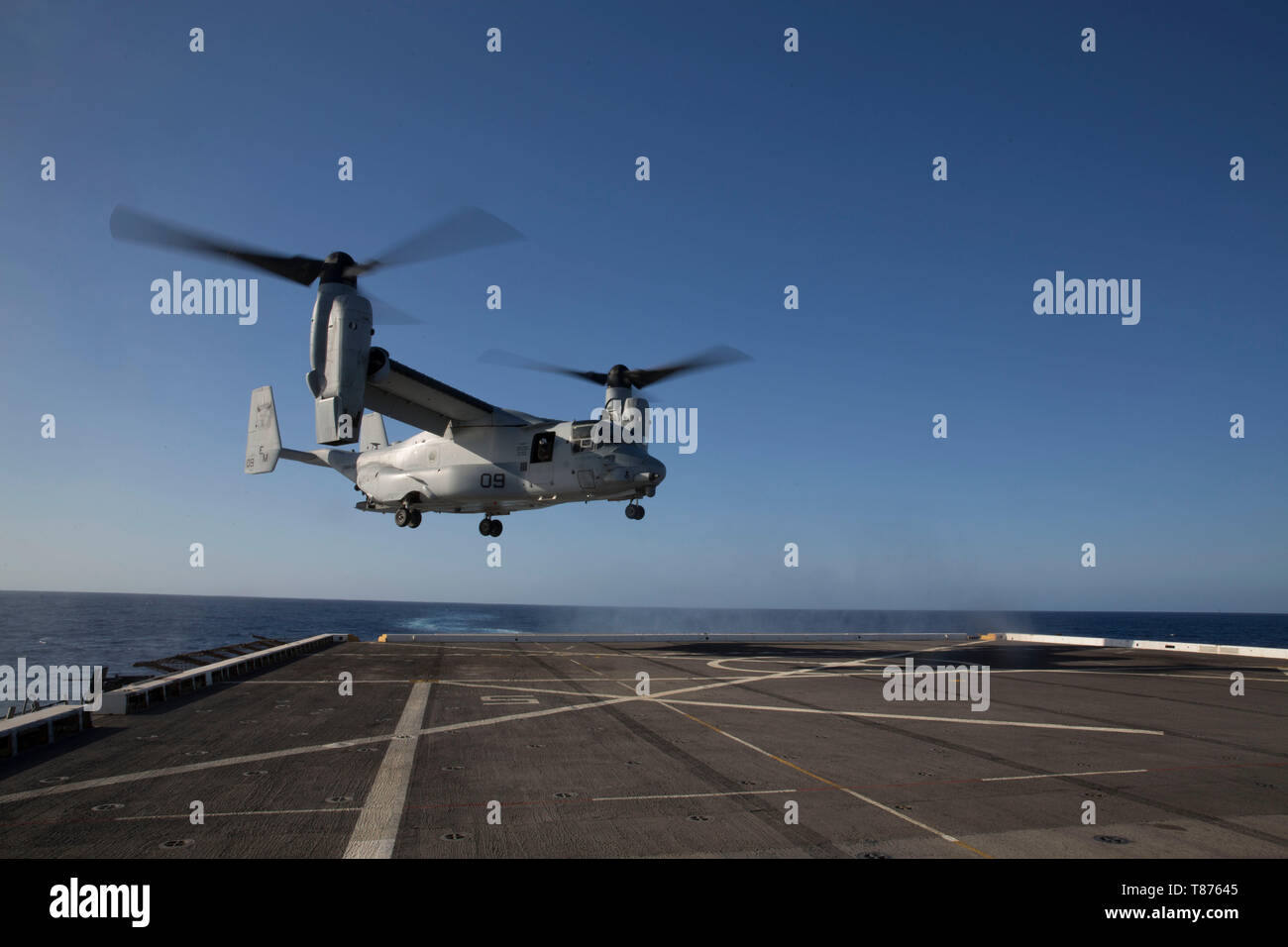 A U.S. Marine Corps MV-22B Osprey with the Special Purpose Marine Air-Ground Task Force-Crisis Response-Africa 19.2, Marine Corps Forces Europe and Africa, lands on the flight deck aboard the USS Arlington (LPD-24) in the Mediterranean Sea, May 6, 2019. SPMAGTF-CR-AF 19.2 conducted deck-landing qualifications to increase proficiency and decrease crisis-response time for contingencies. SPMAGTF-CR-AF is deployed to conduct crisis-response and theater-security operations in Africa and promote regional stability by conducting military-to-military training exercises throughout Europe and Africa. (U Stock Photo