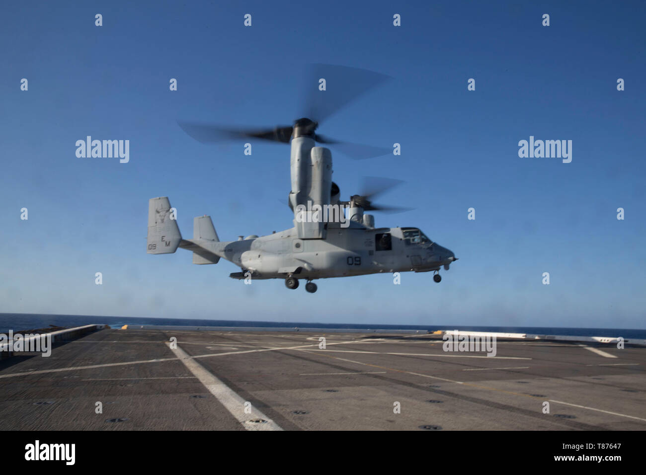 A U.S. Marine Corps MV-22B Osprey with the Special Purpose Marine Air-Ground Task Force-Crisis Response-Africa 19.2, Marine Forces Europe and Africa, takes off of the flight deck aboard the USS Arlington (LPD-24) in the Mediterranean Sea, May 6, 2019. SPMAGTF-CR-AF 19.2 conducted deck-landing qualifications to increase proficiency and decrease crisis-response time for contingencies. SPMAGTF-CR-AF is deployed to conduct crisis-response and theater-security operations in Africa and promote regional stability by conducting military-to-military training exercises throughout Europe and Africa. (U.S Stock Photo