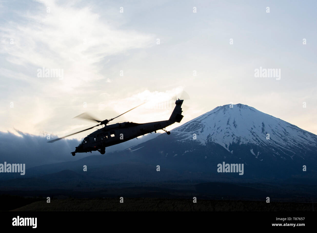 A SH-60 Seahawk Helicopter, with Helicopter Sea Combat Squadron 12, working in coordination with 3rd Battalion, 6th Marine Regiment, currently attached to 3rd Marine Division, with 4th Marine Regiment on the Unit Deployment Program, takes off during a casualty evacuation drill as a part of Exercise Fuji Viper at Combined Arms Training Center, Camp Fuji, May 8, 2019. Naval Aviators worked in coordination with Marine Combined Anti-Armor Teams to evacuate simulated casualties. (U.S. Marine Corps photo by Lance Cpl. Joshua Sechser) - Stock Image
