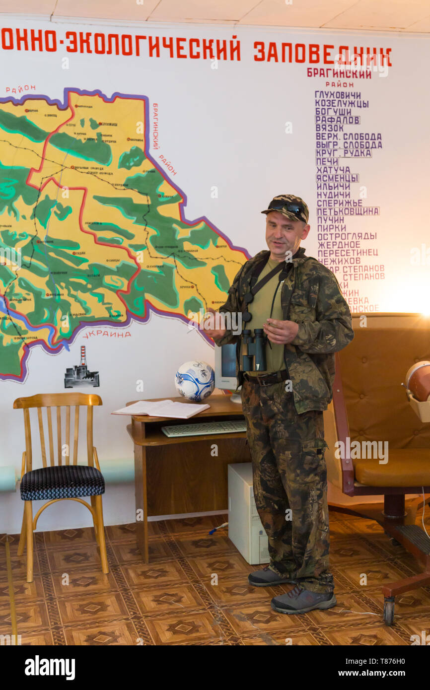 Chojniki, Belarus, - April 26, 2019: Guide telling the Chernobyl accident story in 1986 in the museum of the Belarus exclusion zone of Chernobyl. - Stock Image