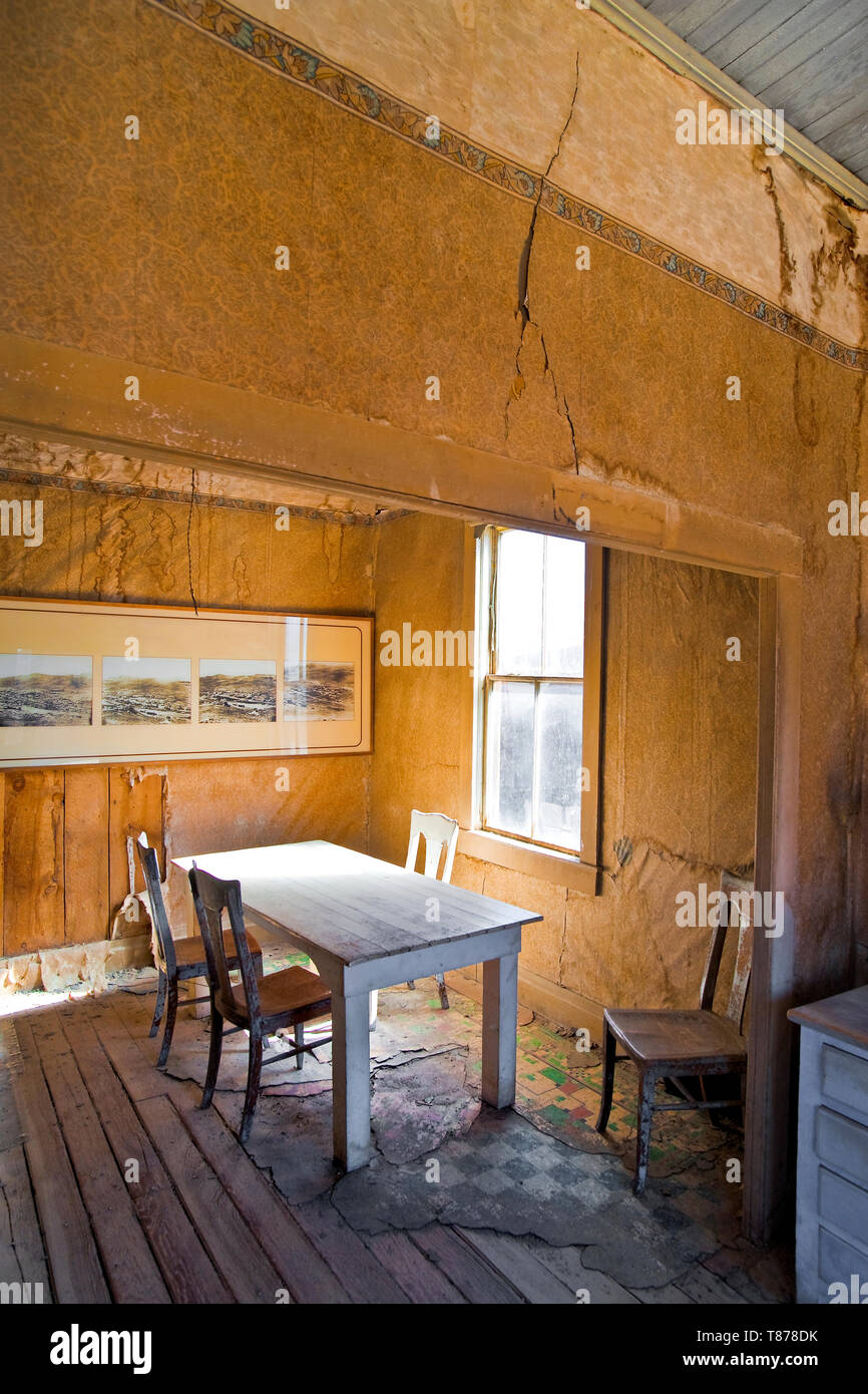 Dining Room in Abandoned Home - Stock Image
