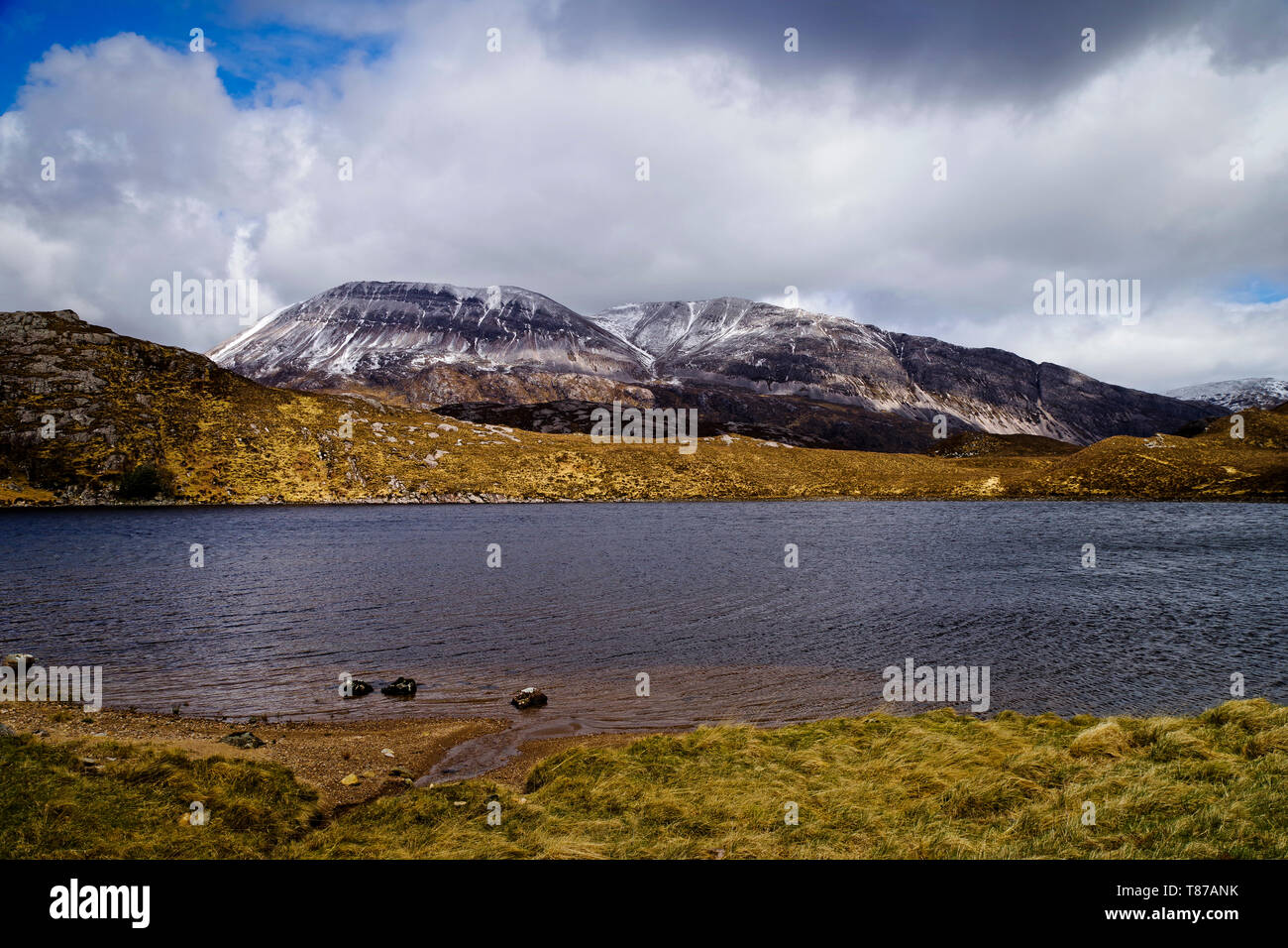 Snow-capped Arkle seen across Loch Stack on a blustery April day, Sutherland, Scottish Highlands, UK - Stock Image