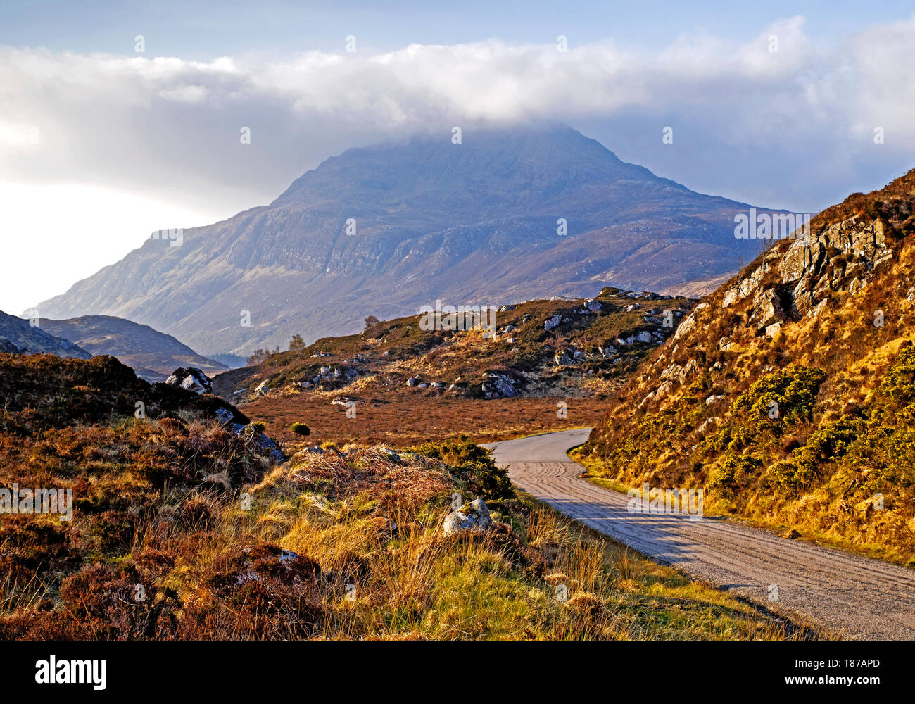Ben Stack seen from A838 road, hazy morning, wispy cloud on summit, Sutherland, Scottish Highlands.UK - Stock Image