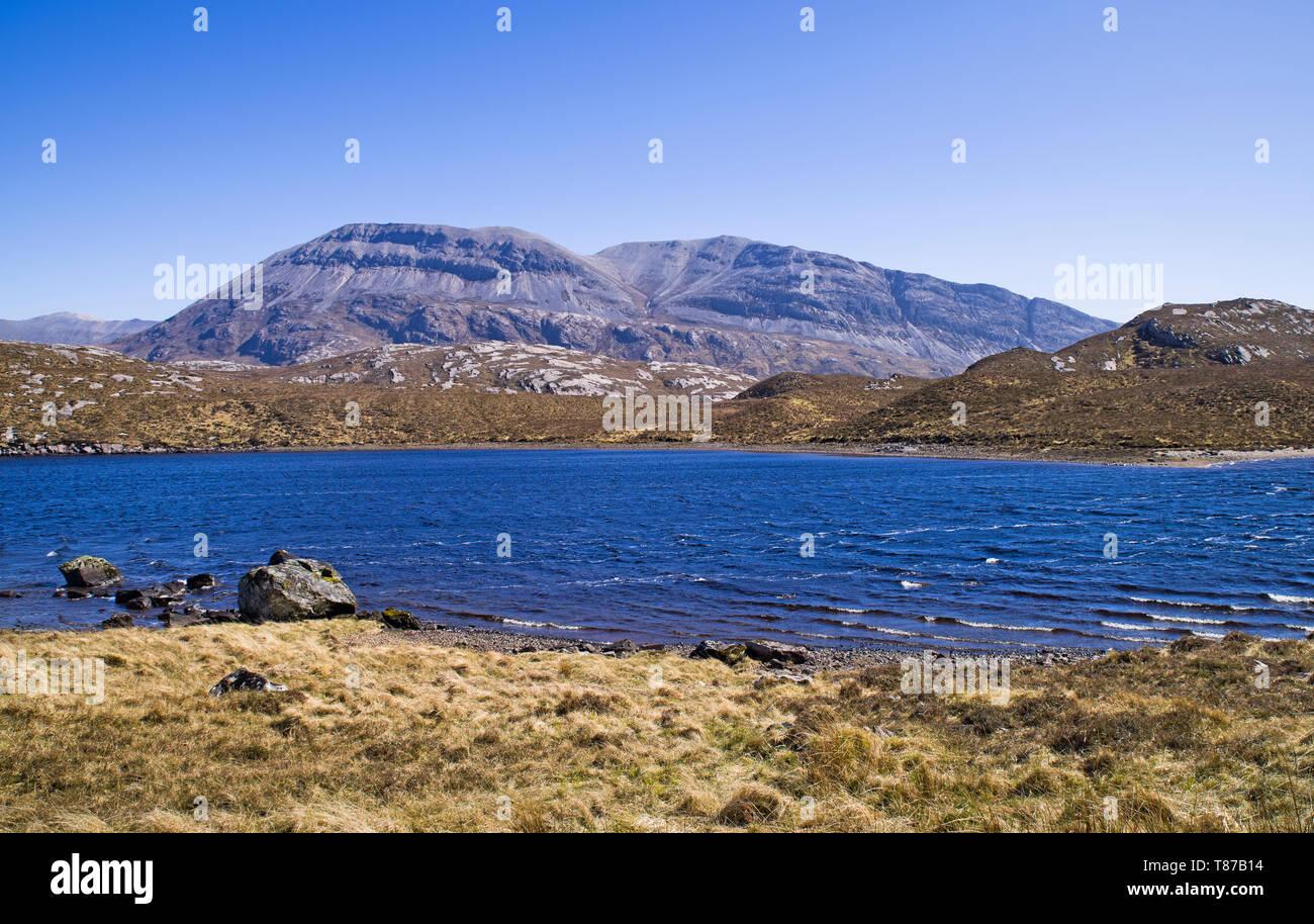 Arkle seen across Loch Stack, bright sunny spring morning, Sutherland, Scottish Highlands, UK - Stock Image