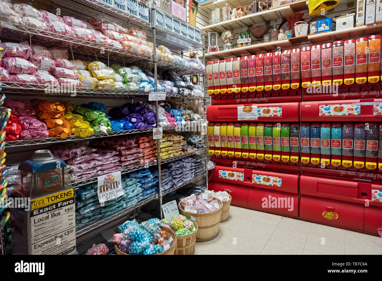 A corner of the iconic ECONOMY CANDY store on the lower east side with chocolates, jelly beans and a vintage token machine. New York City. Stock Photo
