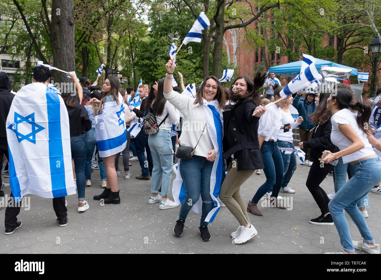 An Israeli & American young lady dance happily at the Israel Independence Day celebration in Washington Square Park in Manhattan,  NYC. Stock Photo