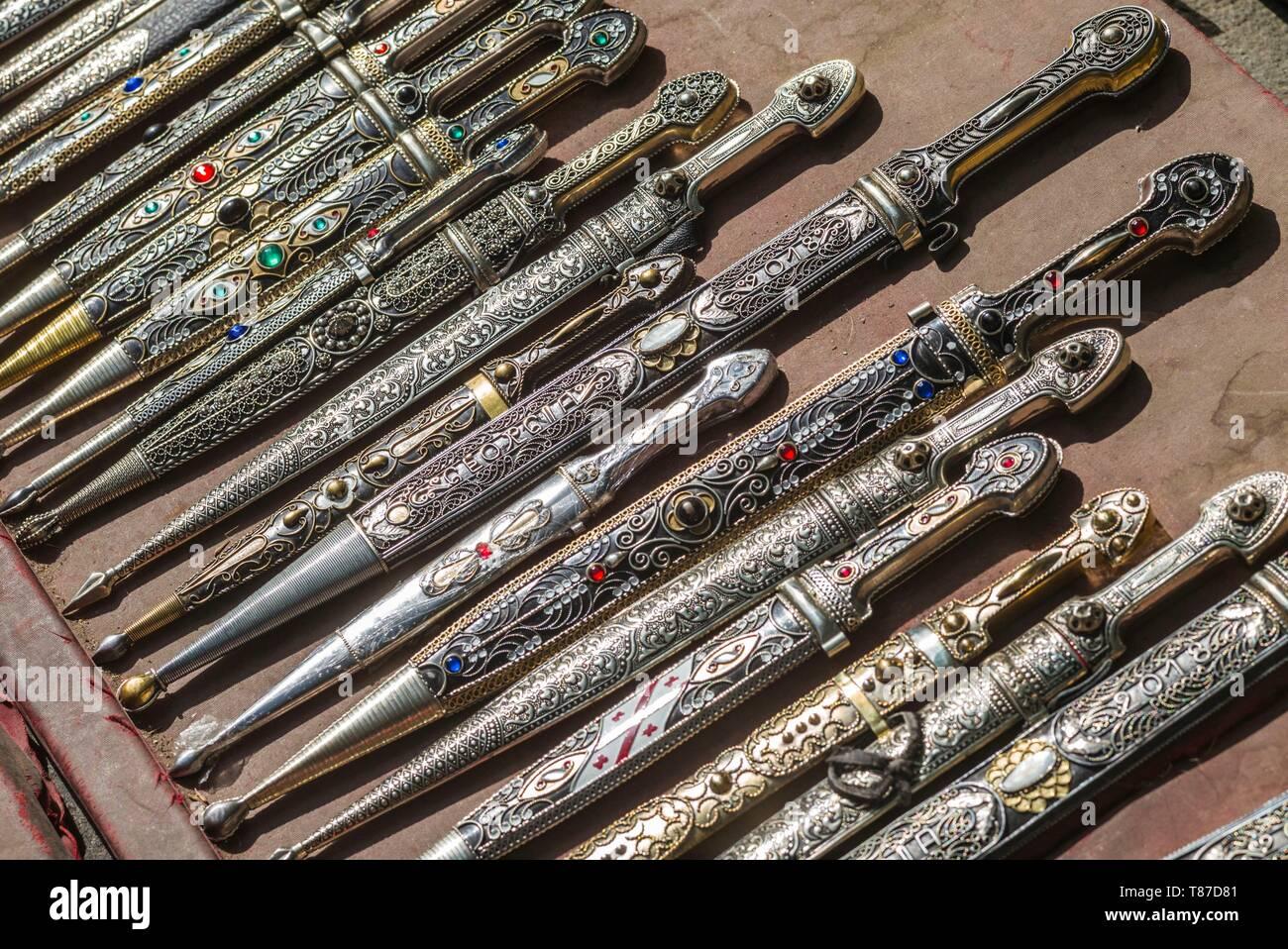 Georgia, Tbilisi, Rustaveli Avenue, souvenirs, traditional Georgian daggers - Stock Image