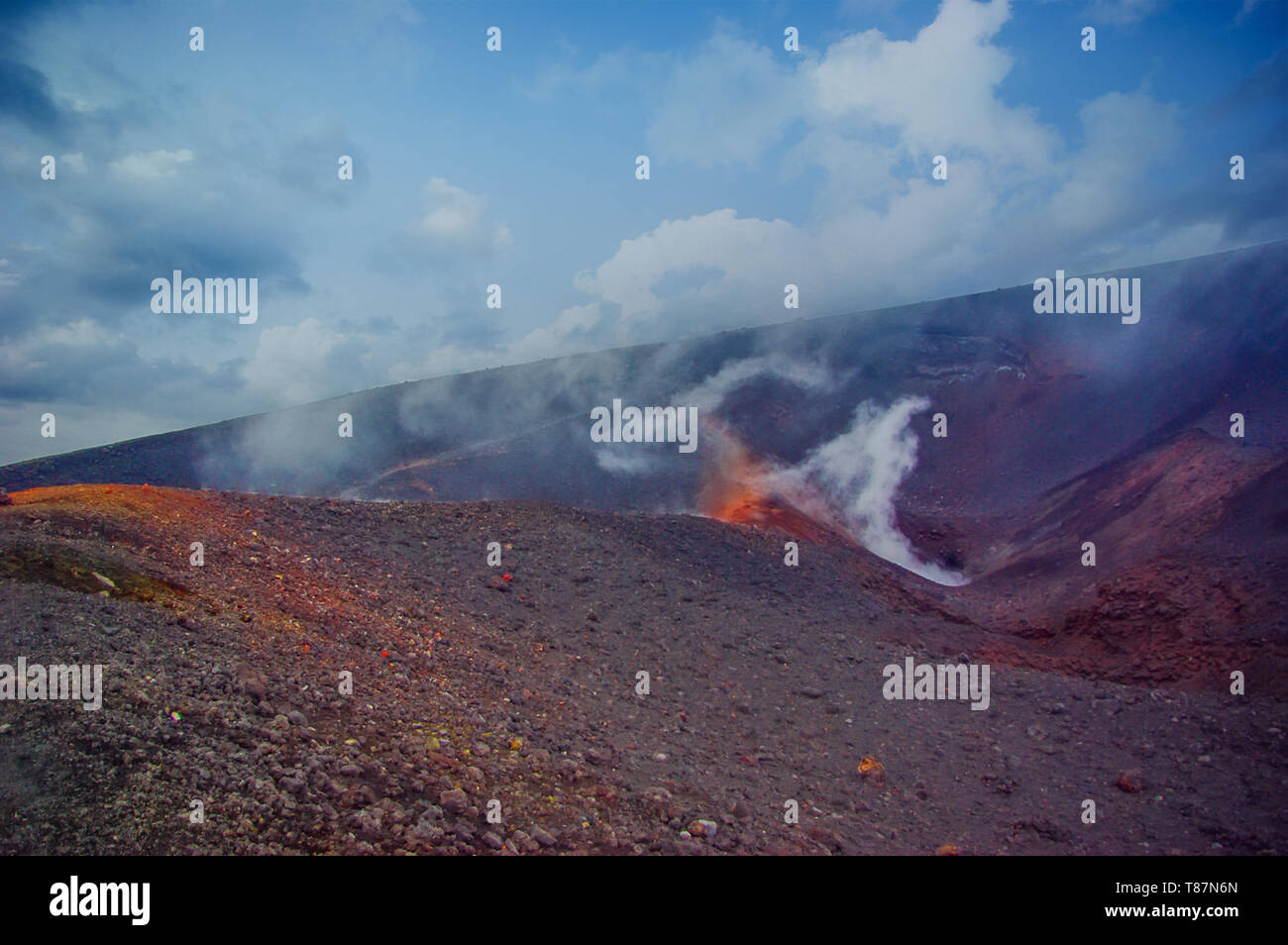 Mountain crater active volcano. smoke comes out of a volcano vent - Stock Image