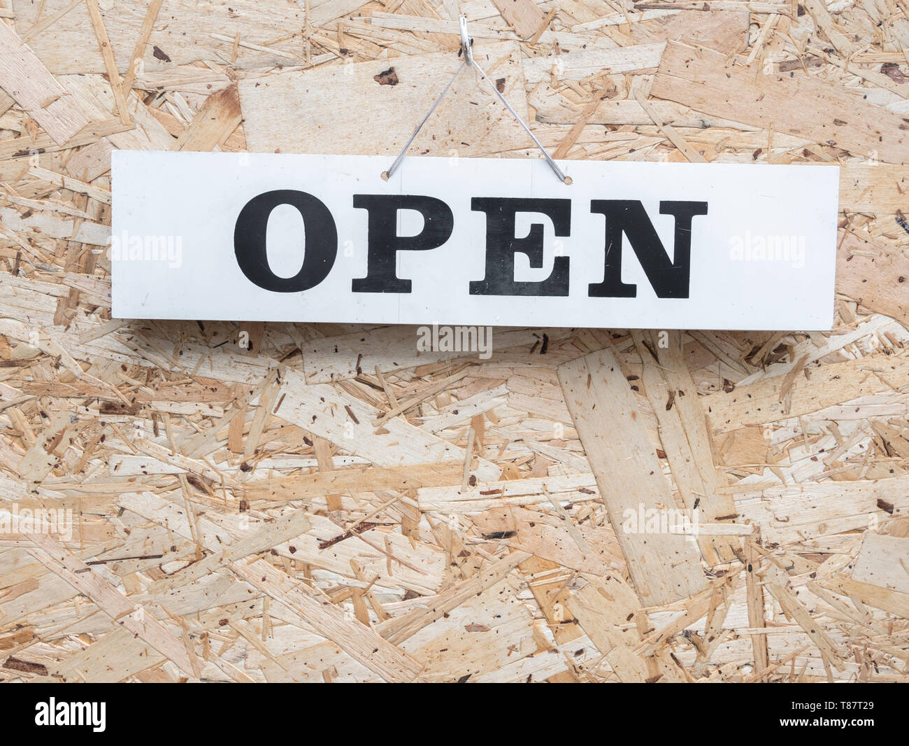 Business 'Open' sign on workshop door, with room for copy text or PIP. Metaphor 'Open as Usual', doing business, Open and Closed concept. Stock Photo