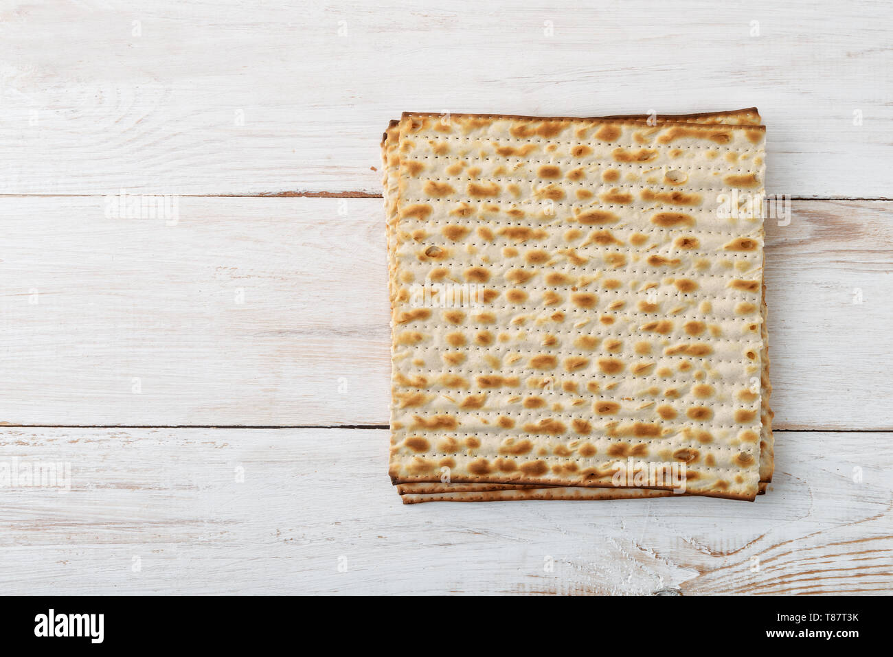 Top view of flatbread matzo on wooden background - Stock Image