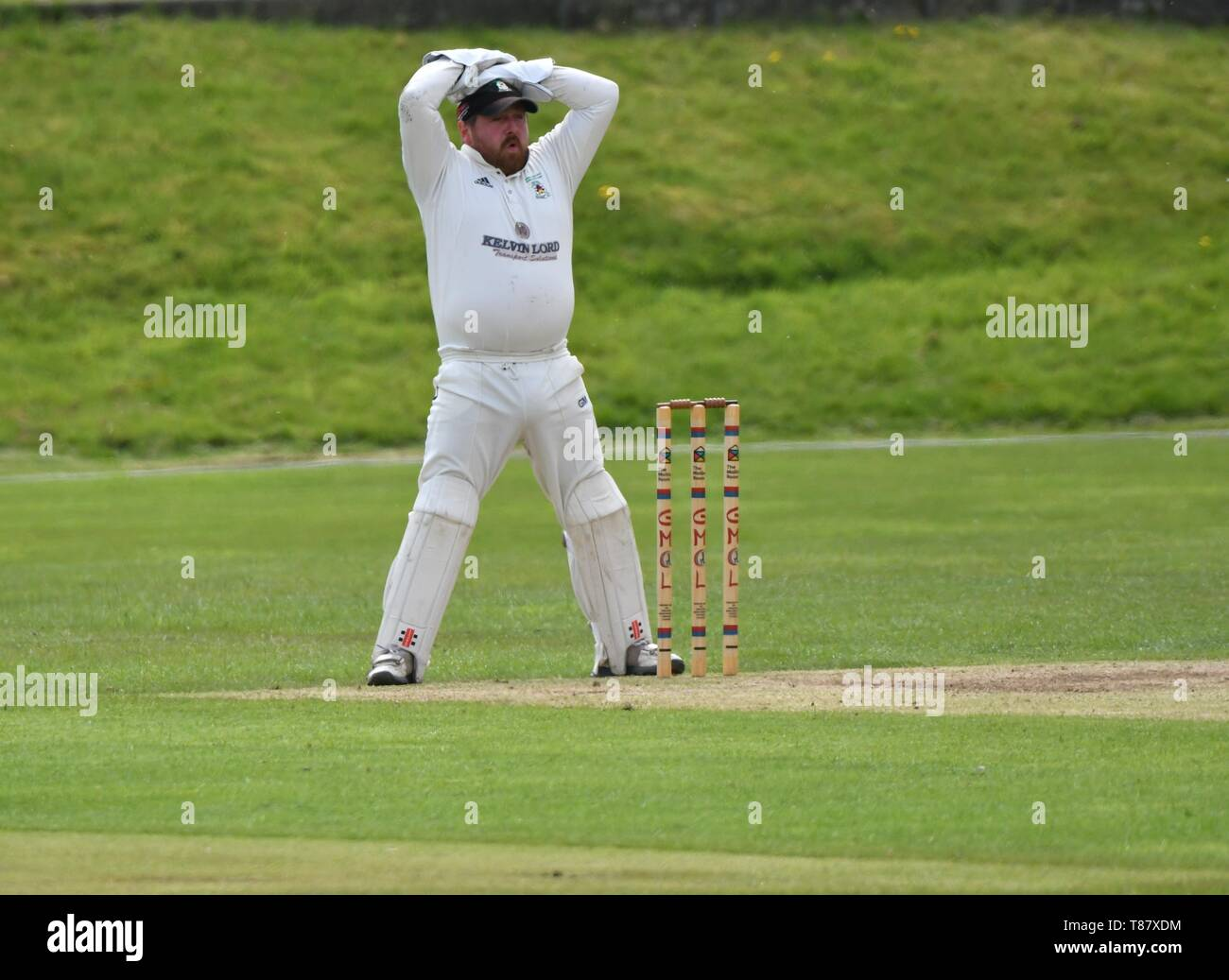 Wicket keeper shows his disbelief  in the match between Glossop and Moorside. - Stock Image