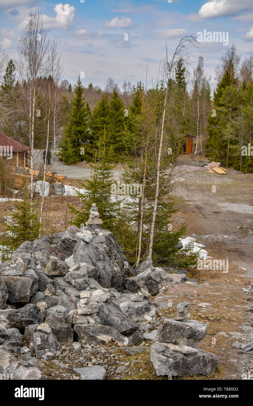 Stone pyramids built by tourists from pieces of marble in the mountain Park Ruskeala. - Stock Image