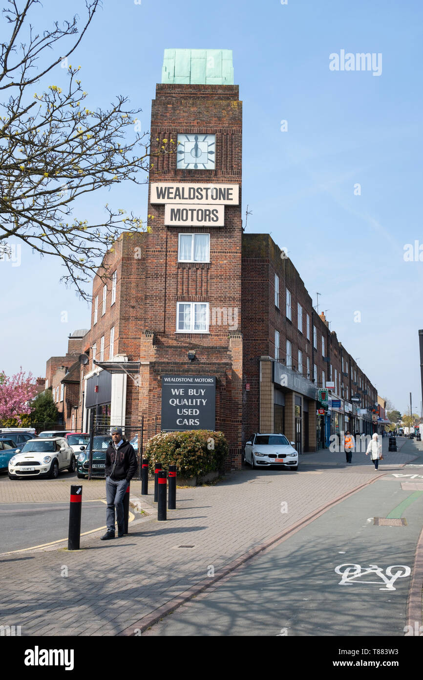 Wealdstone Motors garage in North Harrow occupy an Art deco clock tower and car showrooms in North Harrow, built as part of a parade featuring shops a - Stock Image