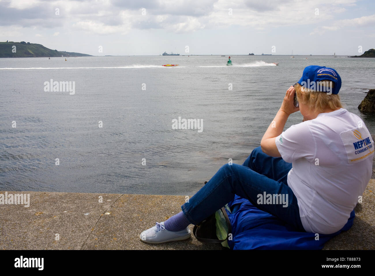 Fans watch the powerboats race across the water. Stock Photo