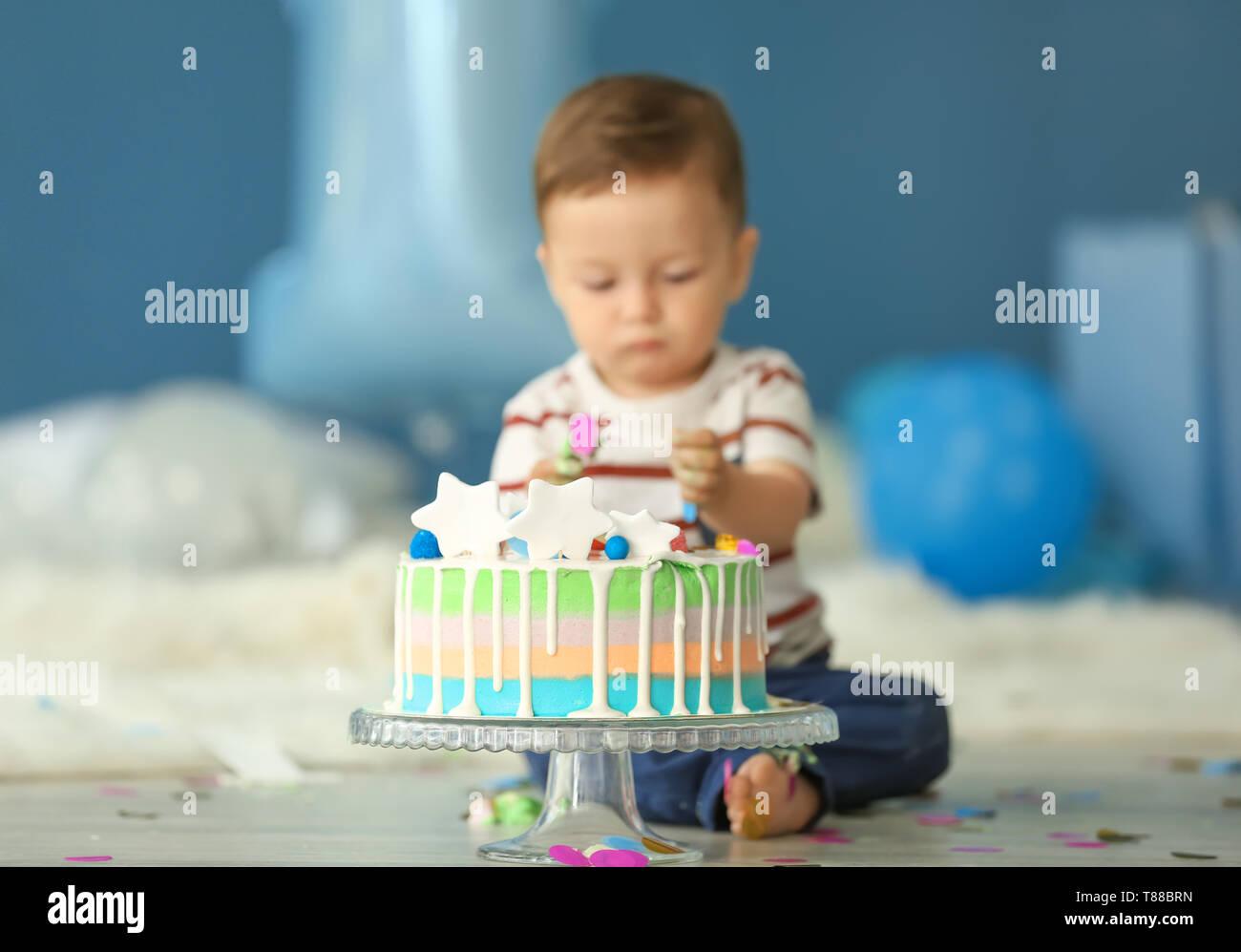 Groovy Cute Little Boy With Birthday Cake Sitting On Floor In Room Stock Birthday Cards Printable Nowaargucafe Filternl