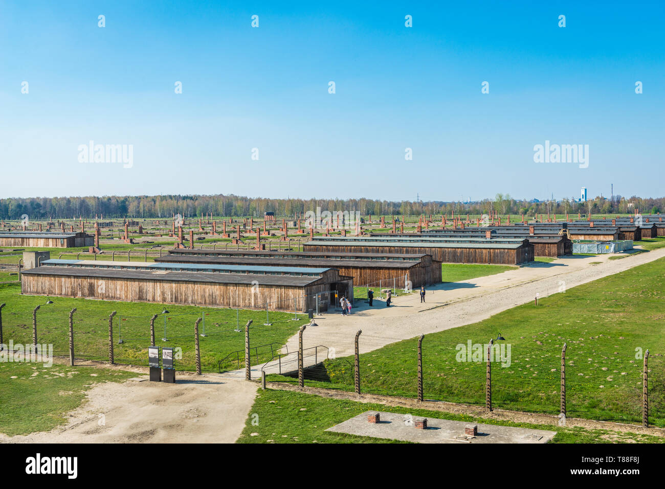 AUSCHWITZ (OSWIECIM), POLAND - APRIL 18, 2019: Aerial view over the concentration camp with some remaining barracks in Auschwitz Birkenau exterminatio - Stock Image