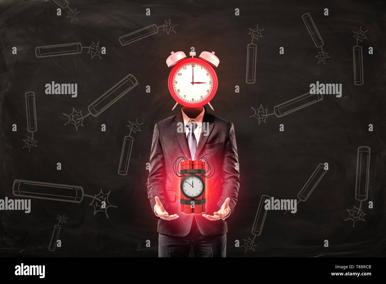 Businessman with red alarm clock instead of head holding big red dynamite time bomb on black background Stock Photo