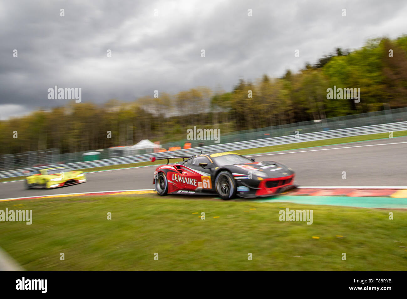 Ferrari 488 races another car into Les Combes. WEC Total 6 Hours of Spa-Francorchamps Stock Photo
