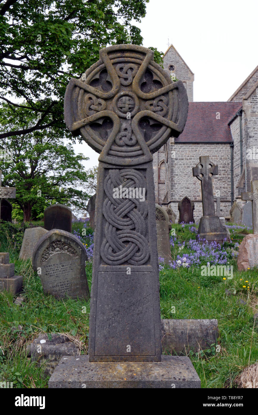 Celtic cross in a graveyard in Wales. - Stock Image