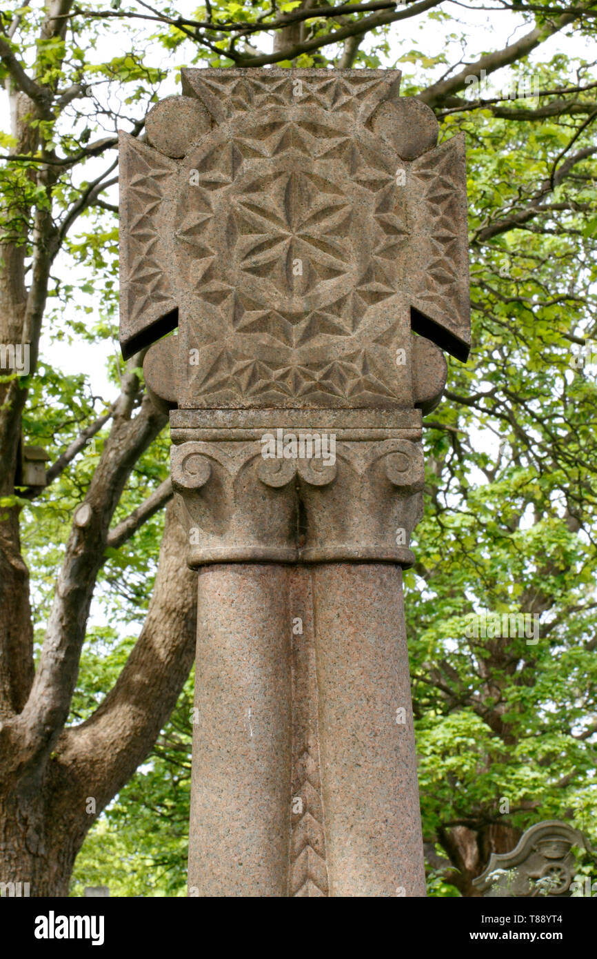 Unusual decorated incised cross on a gravestone . Grave marker - Stock Image