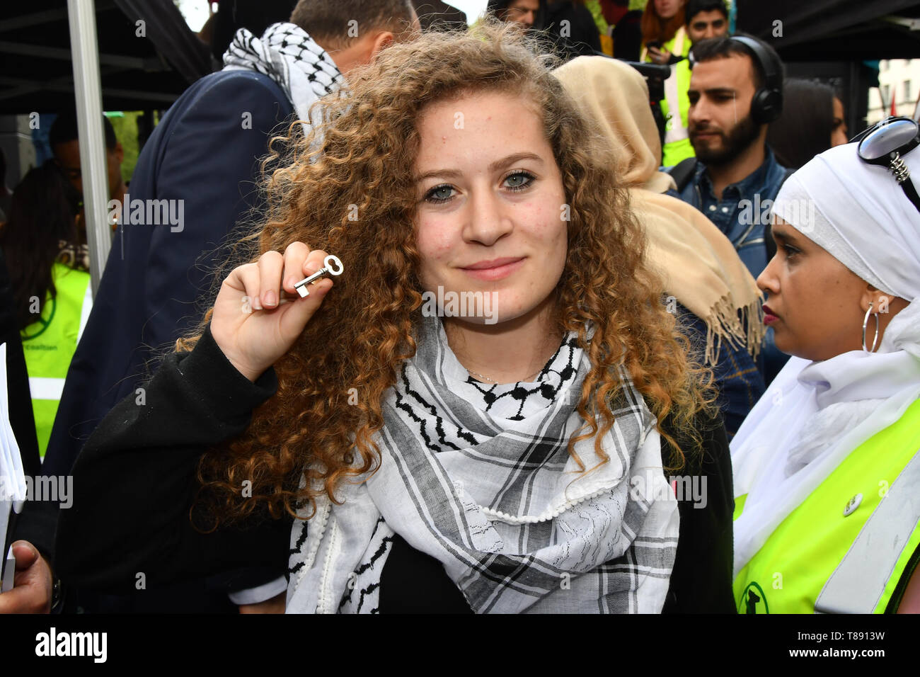 Speaker Ahed Tamimi is a Palestinian continues rally outside Downing street of the Nakba: National Demonstration for Palestine commemorating 71 years since the Nakba (catastrophe). On 15th May 1948 over 750,000 Palestinians were expelled from their land during the establishment of the state of Israel ahead of the Nakba (catastrophe). on this day 15th May 1948 march through central on 11 May 2019, London, UK. - Stock Image
