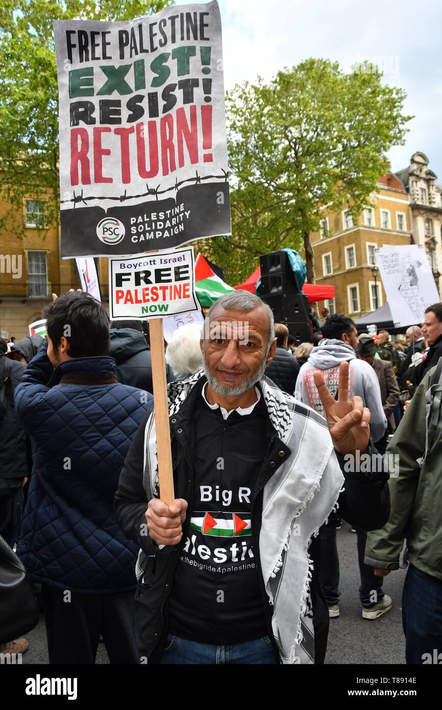 Thousands continues rally outside Downing street of the Nakba: National Demonstration for Palestine commemorating 71 years since the Nakba (catastrophe). On 15th May 1948 over 750,000 Palestinians were expelled from their land during the establishment of the state of Israel ahead of the Nakba (catastrophe). on this day 15th May 1948 march through central on 11 May 2019, London, UK. - Stock Image