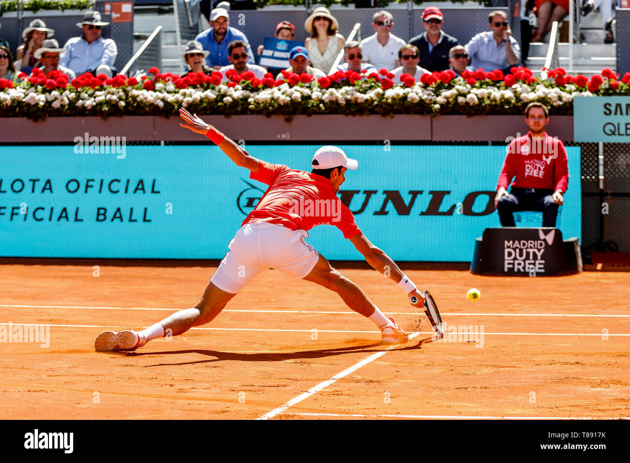 Caja Magica, Madrid, Spain. 11th May, 2019. Mutua Madrid Open, day 8; Novak Djokovic (SRB) at the net for a drop volley Credit: Action Plus Sports/Alamy Live News - Stock Image