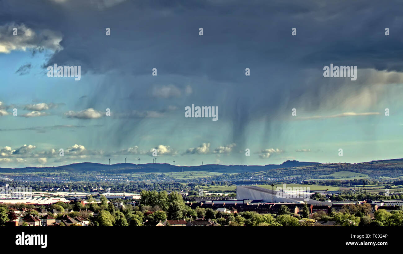 Glasgow, Scotland, UK, 11th May, 2019, UK Weather. Even when the sun shines it pours as rain veins appear over the south of the city and the Intu shopping centre at Braehead, Credit Gerard Ferry/Alamy Live News - Stock Image