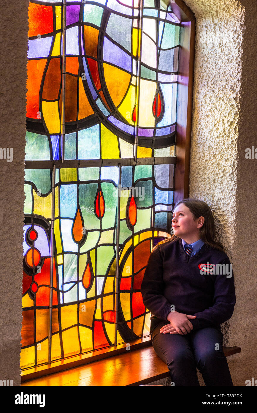 Dungloe, St Crona's Church, County Donegal, Ireland. 11th May 2019. Emma Fleury sits in the chapel before her confirmation service. Credit: Richard Wayman/Alamy Live News Stock Photo